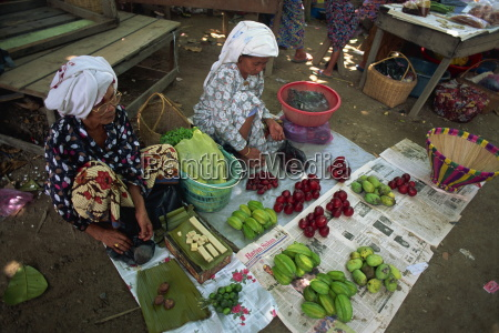 women selling local produce including star