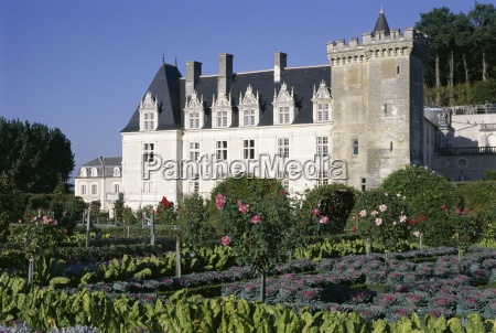 chateau and gardens including vegetables in
