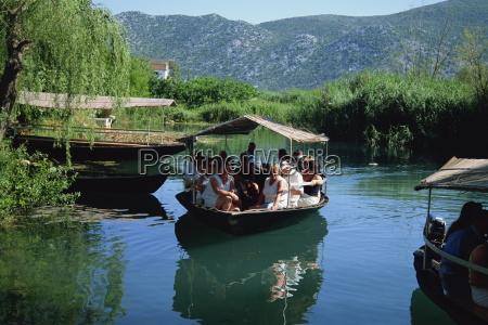 tourists in local boats neretva delta