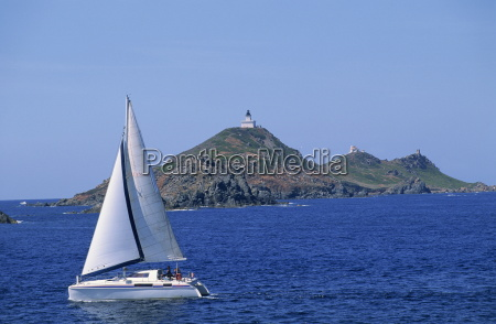sailing boat with the semaphore lighthouse