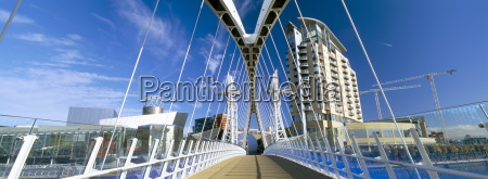 view along pedestrian suspension bridge at