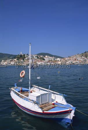 small boat in harbour on poros