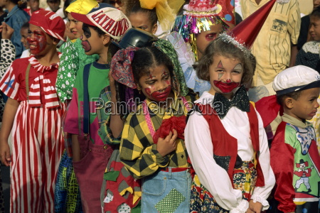 portrait of children with painted faces