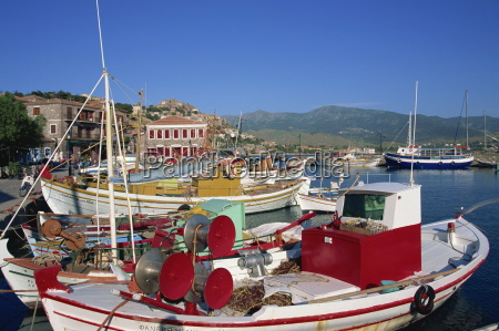 fishing boats moored in harbour at