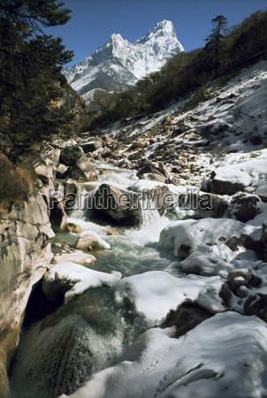mountain stream and peaks beyond himalayas