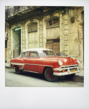 polaroid of red classic american car