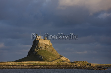 lindisfarne castle bathed in afternoon sunlight