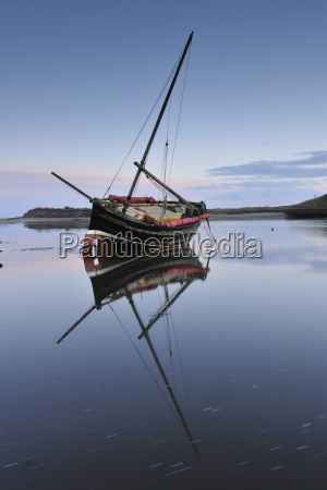 old ketch reflecting in aln estuary