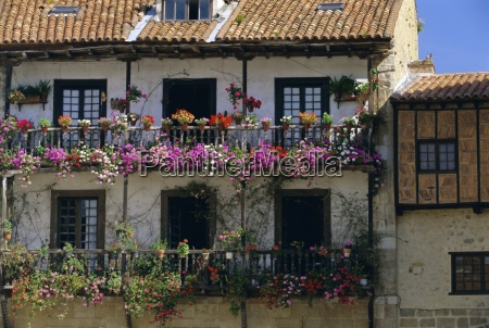 house with balconies and flowers santilla