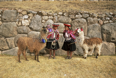 local women and llamas in front