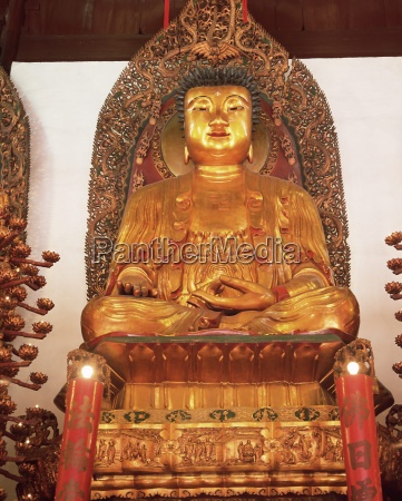 gold seated buddha statue heavenly king