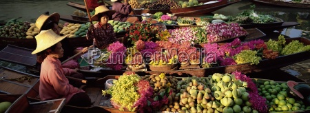 women market traders in boats laden