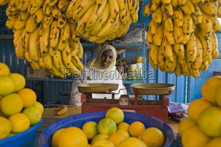woman selling fruit in a market