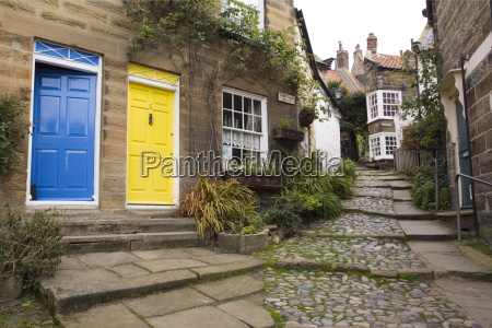 yellow and blue doors on houses