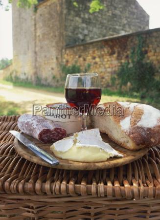 still life of bread glass of
