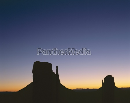 silhouettes of mitten rock formations at