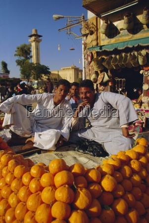 market traders by their orange stall