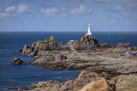 corbiere lighthouse and rocky coastline jersey
