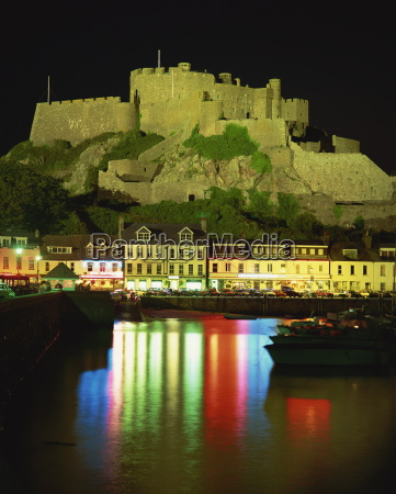 mont orgueil and harbour by night