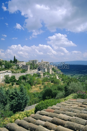 view over rooftops to village gordes