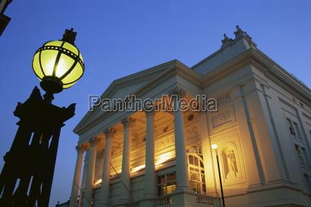 the royal opera house illuminated at