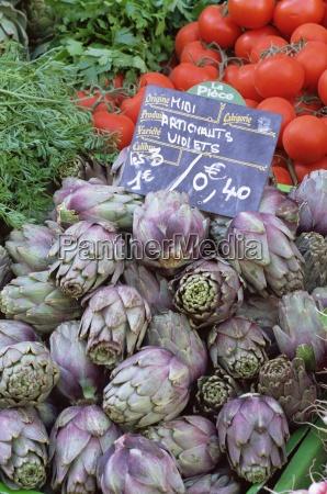 artichokes for sale on market in