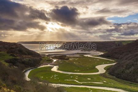 pennard pill overlooking three cliffs bay