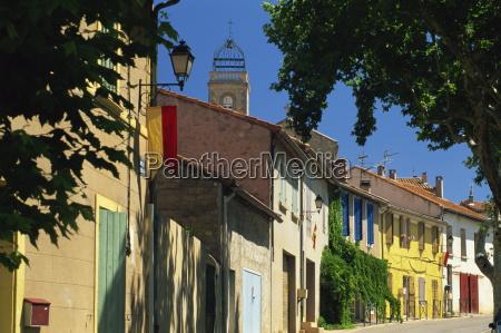 colourful houses and church puyloubier near