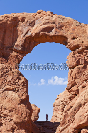 lone hiker in turret arch arches