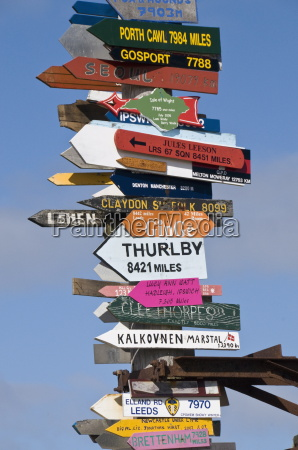 signs, with, mileage, to, world, destinations - 20669689