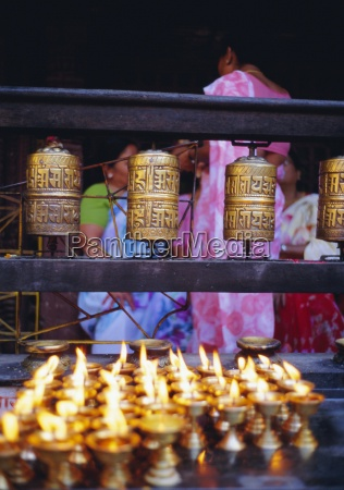 lamps and prayer wheels gold temple