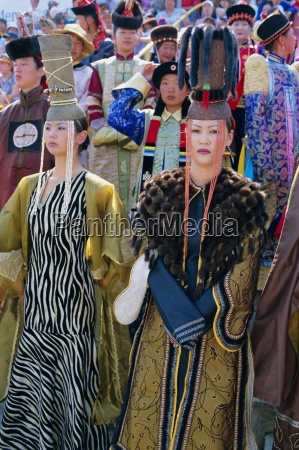 people in traditional costumes at the