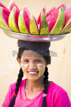 local woman with thanakha traditional face
