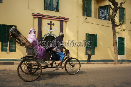 rickshaw in front of st josephs