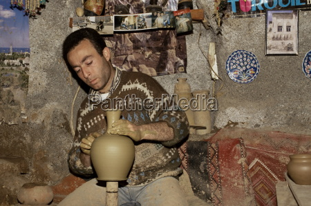 turkish craftsman modelling pottery by hand