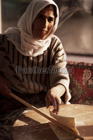 woman kneading traditional turkish pide goreme