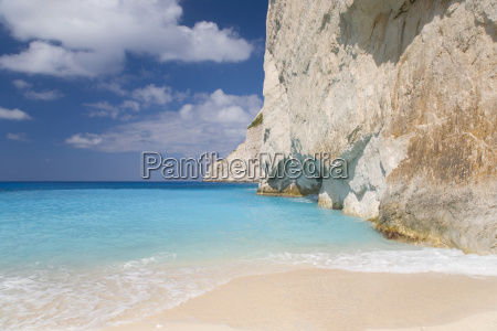 limestone cliffs towering above turquoise sea