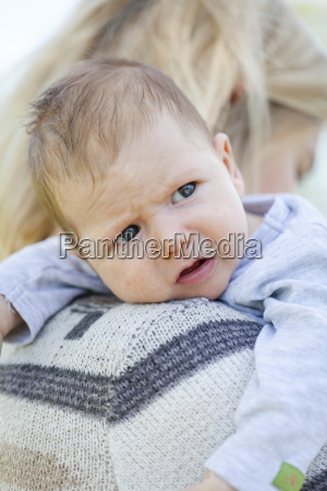 young mother with newborn baby outdoors