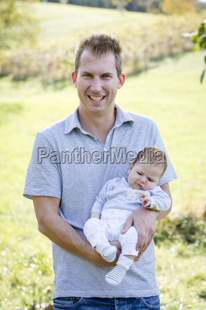 happy young father with newborn baby