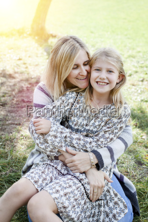 happy mother and daugther outdoors