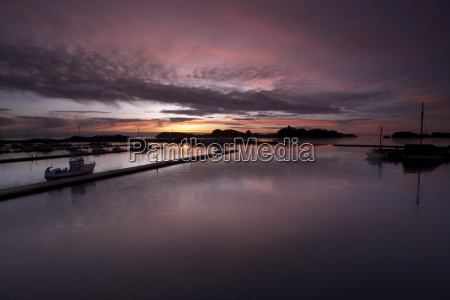 harbour in stavern at dawn norway