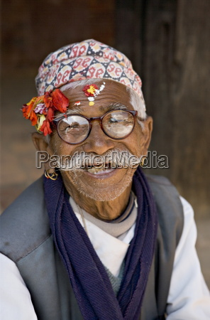 old nepali man wearing topi hat
