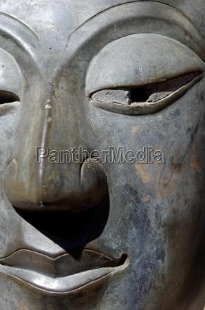 detail of buddha statue at wat