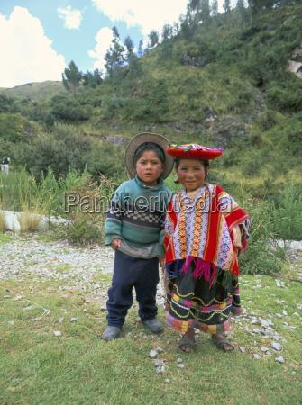two children near machu picchu peru