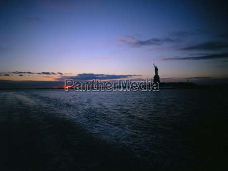 statue of liberty at sunset new