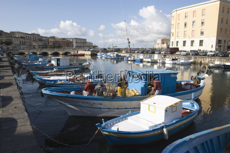 traditional fishing boats in harbour ortygia