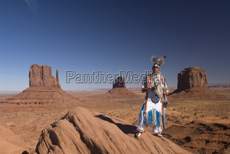 navajo man in traditional costume with