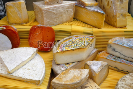 assorted french cheeses on a market