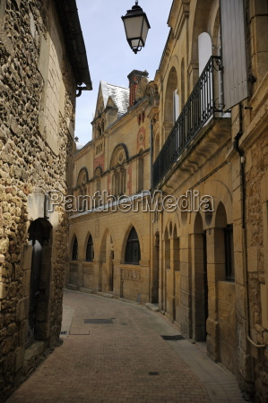 street of medieval stone houses belves