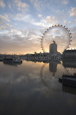 the london eye reflected in the